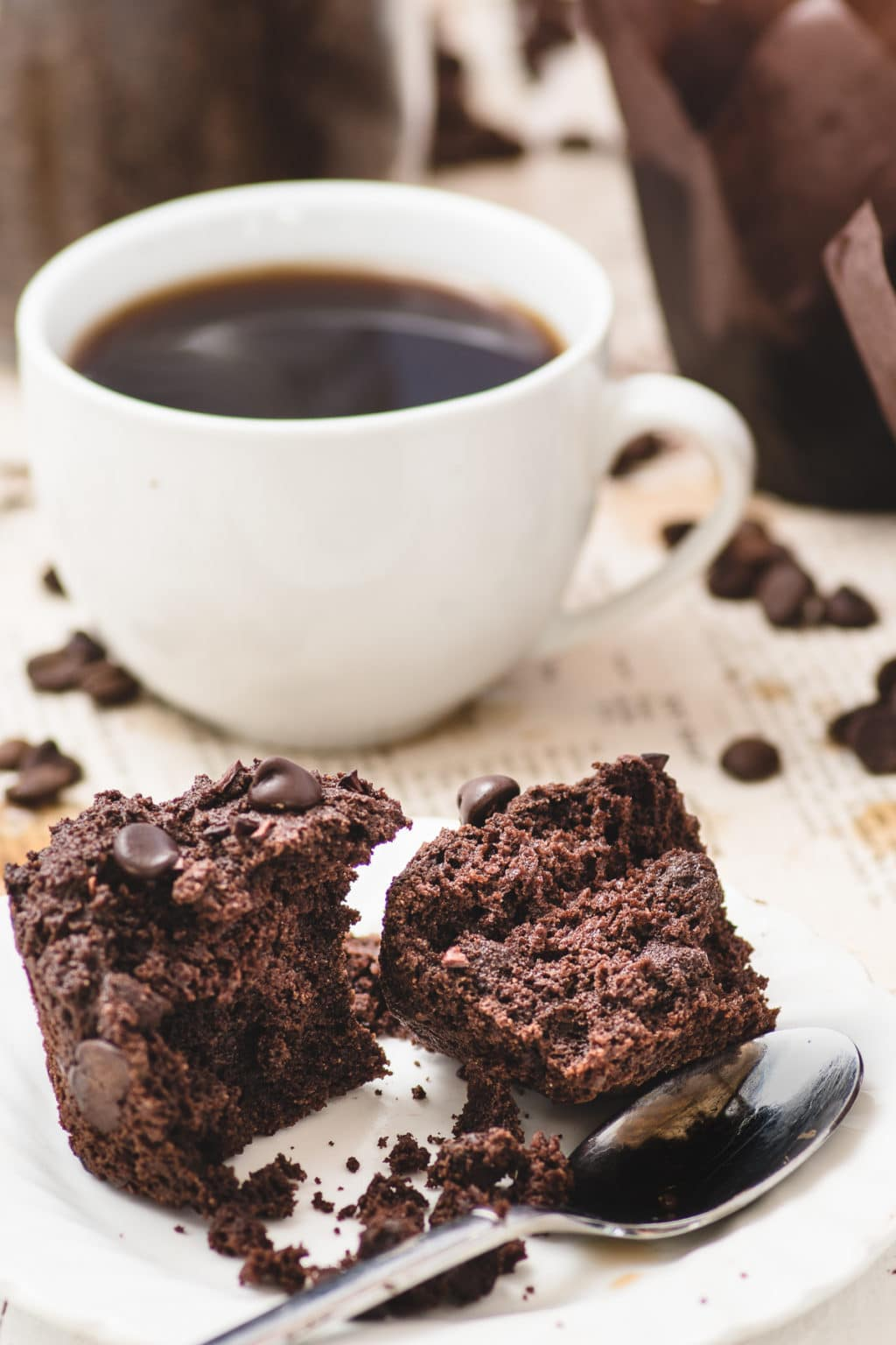 Cup of hot black coffee and dark chocolate muffin