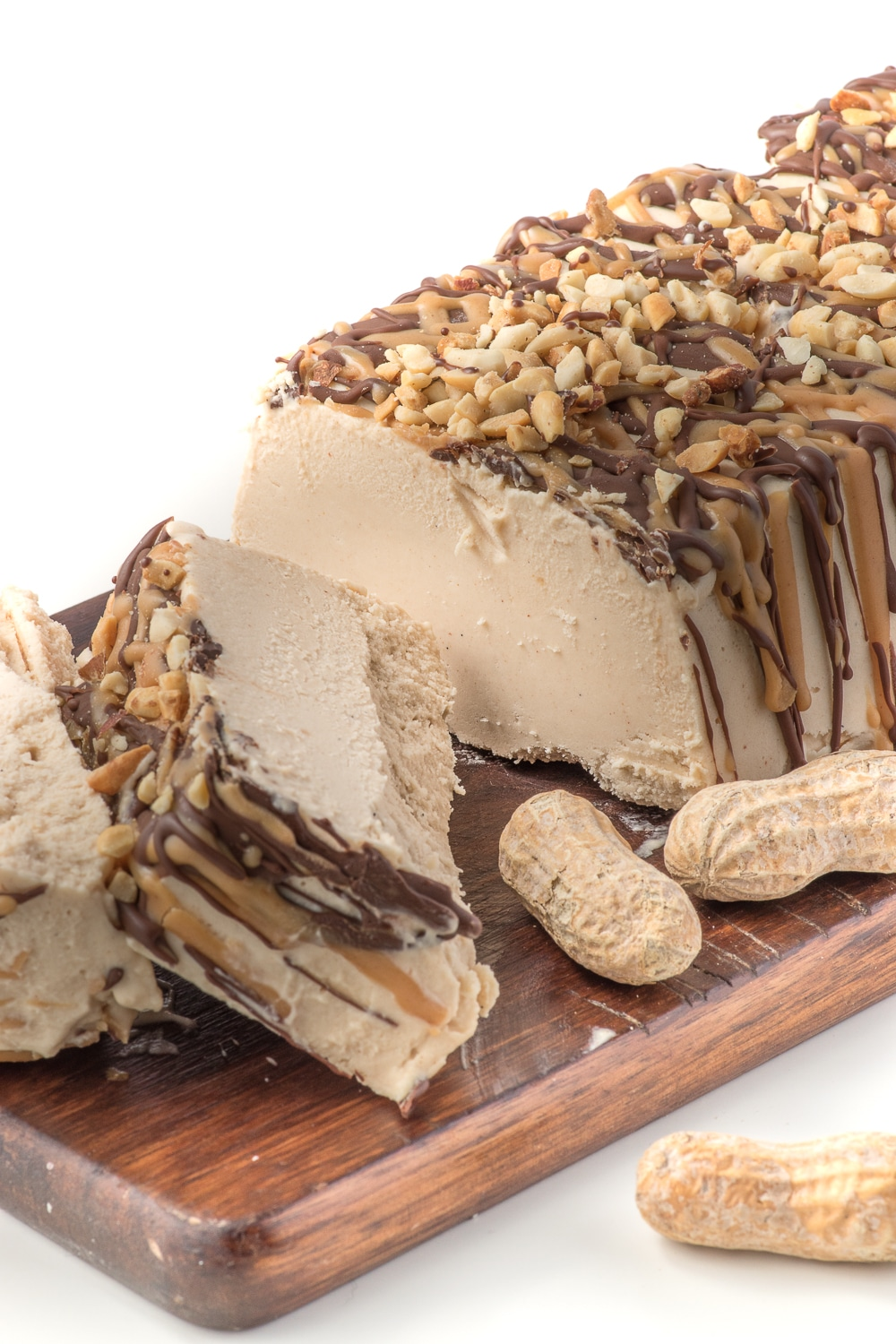 a loaf shaped peanut butter ice cream cake sliced on a cutting board