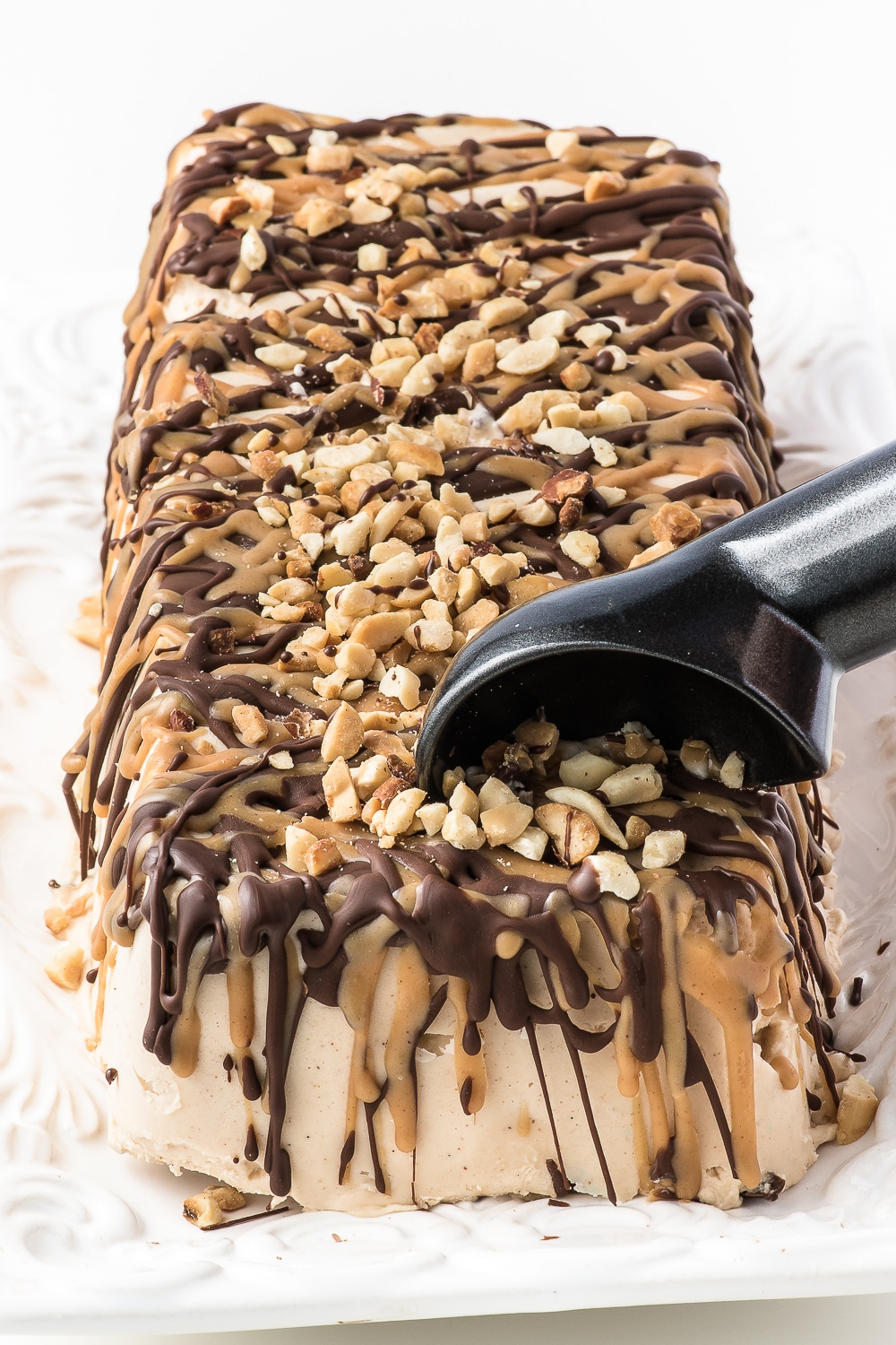 loaf shaped ice cream cake with chocolate and peanut butter drizzle