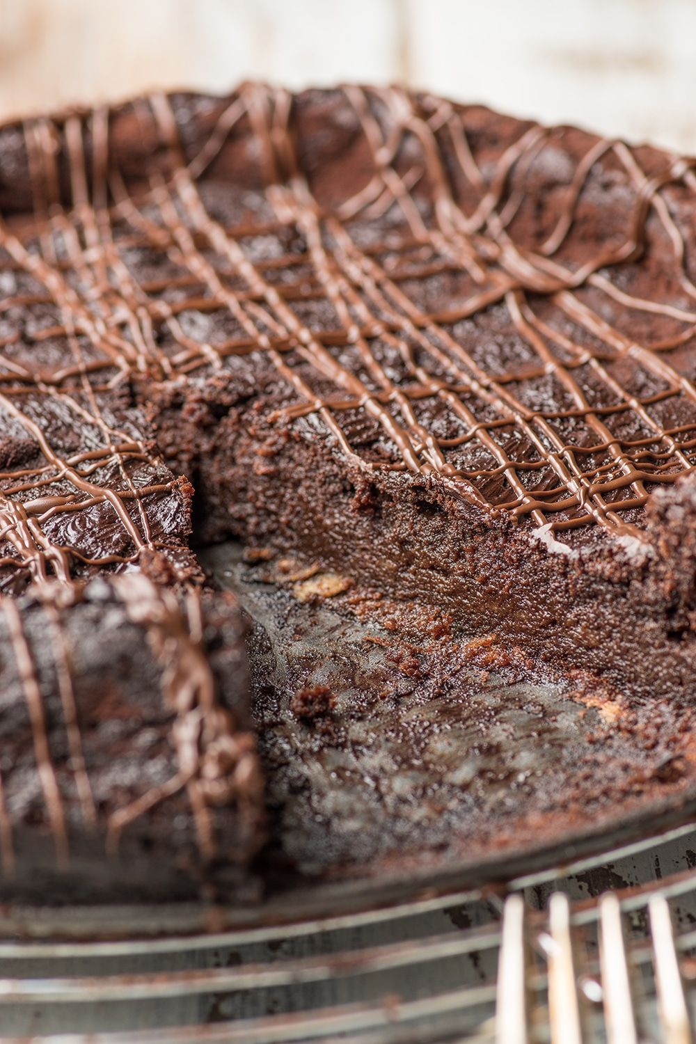 chocolate torte with a piece removed, up close shot to show the inside fudgy texture