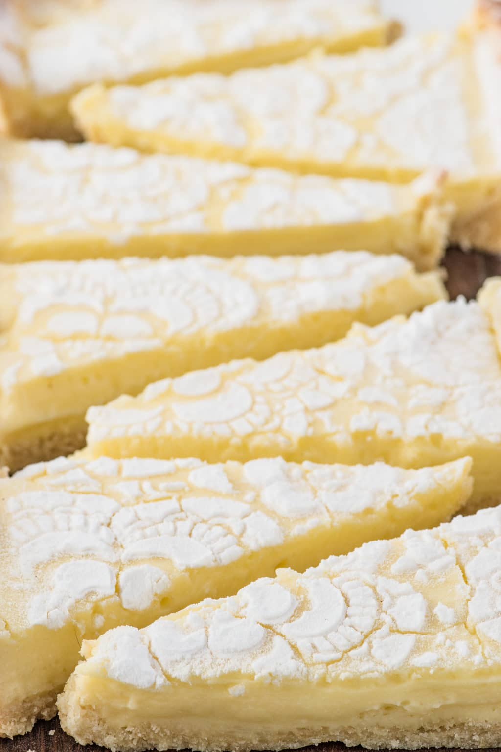Triangular slices of bright yellow lemon tart