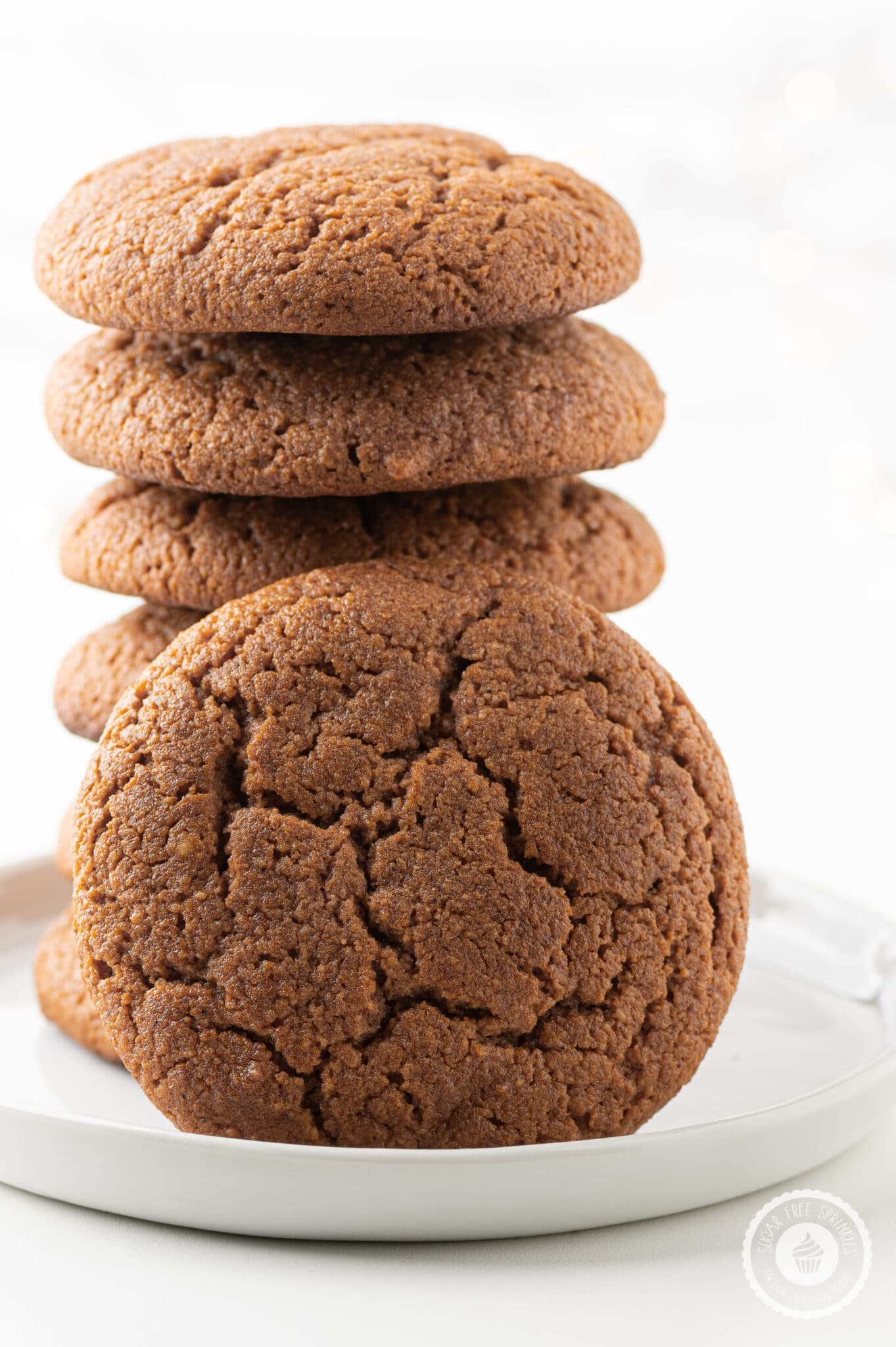 a stack of cookies on a white plate