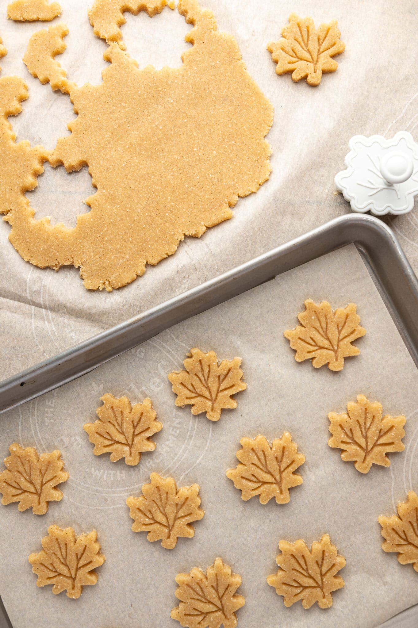 Cookie tray of unbaked maple leaf shaped pie decorations