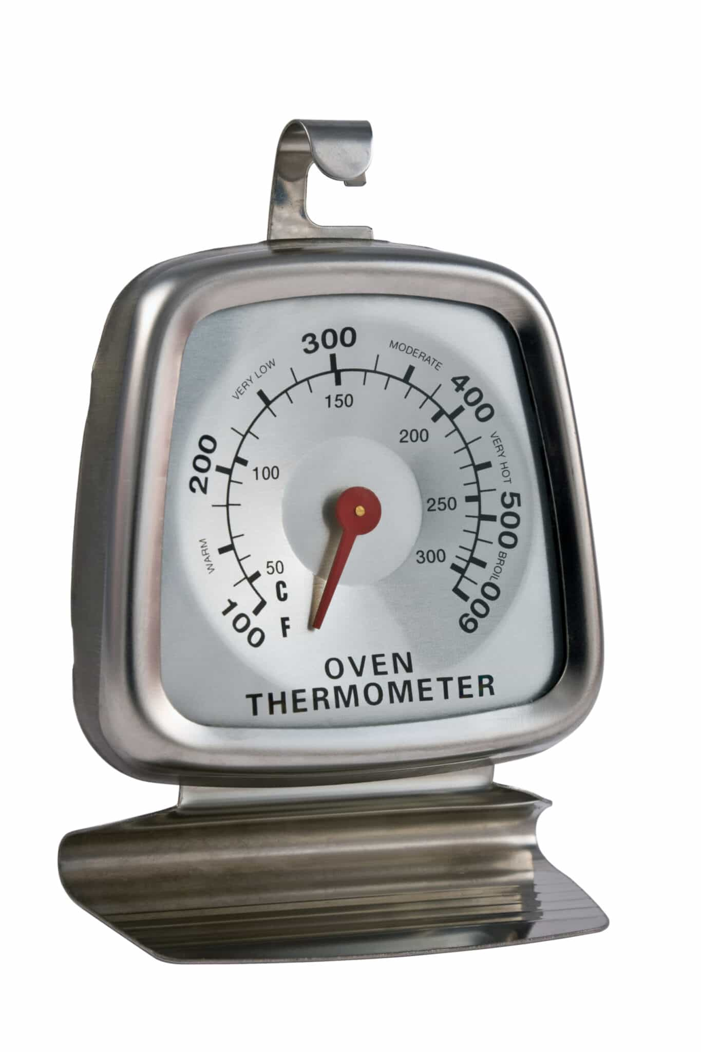 An oven thermometer on a bright white back background