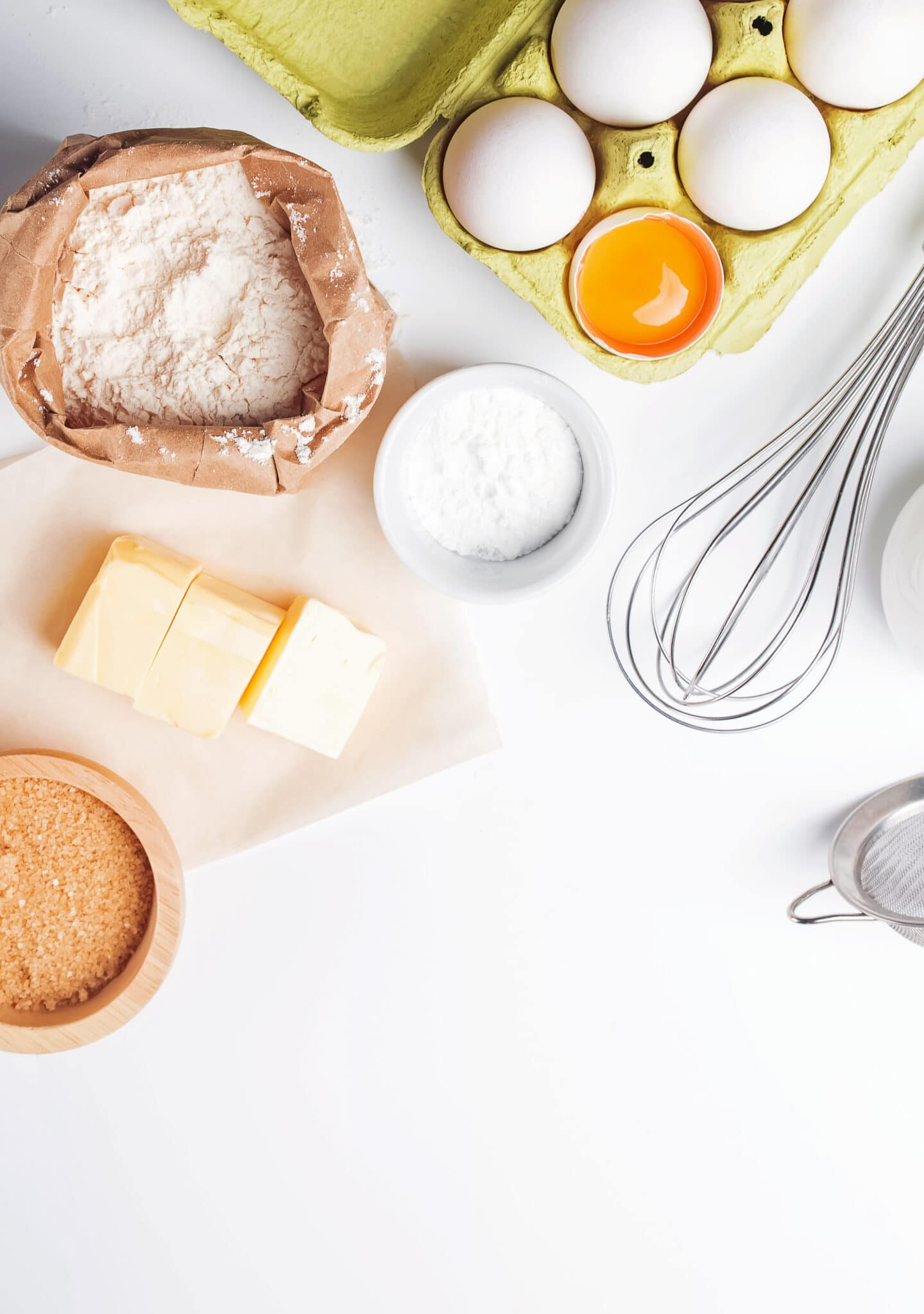 Baking ingredients on a bright white background.