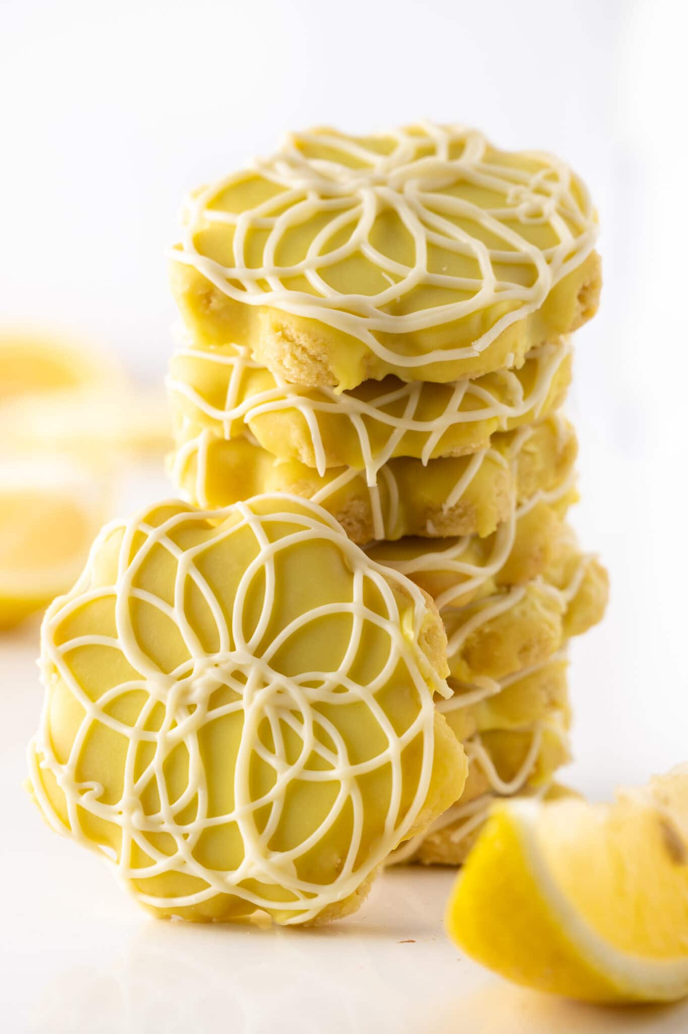 A stack of low carb lemon cookies on againss a bright white background.